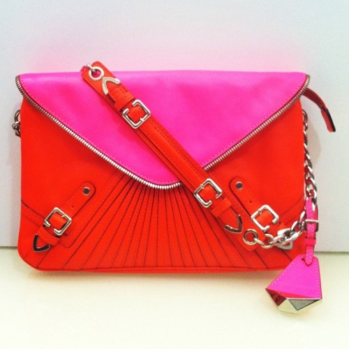 teenvogue:  Here's one for the wishlist: Hot pink and orange clutch from Rebecca Minkoff Spring 2012 Still looking for the perfect holiday purse? Check out our top picks for the season here »
