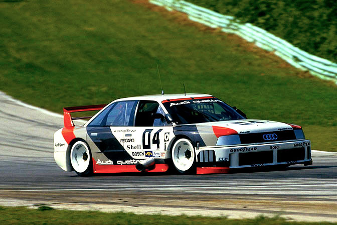 "beautifullyengineered:  The Audi 90 IMSA GTO is Beautifully Engineered In this editor's opinion, in the top 5 best engine sounds in the world, ever. LISTEN Speedhunters.com has written a more complete profile of this car than I have found anywhere else on the internet. They have excellent pictures and informative, clear writing (as is usual for Speedhunters) about the car, and it would be a crime for this blog to butcher their layout and presentation by posting it here. If you would like to view the Speedhunters article, please go here. Video: Audi demonstrates the IMSA GTO Audi Documentary ""The Secrets of Speed"" IMSA GTO segment  This is the Audi that essentially pulled Audi from the brink. In the mid to late 80's, Audi was mired in lawsuits alleging their cars were the subject of ""unintended acceleration"". Sales dropped significantly but the company pressed on. It was around this time that I fell in love with the IMSA GTO Audi 90. I happened to catch a race on tv and I was immediately drawn to the spectacle of its super-wide bodywork. But it was the sound of it, under braking, going around a turn with all four of its tires chirping during deceleration that beckoned my attention. Granted, with over 700 hp it was fast but I had never witnessed anything like it when it was slowing down which is where the all-wheel drive system gave it a distinct advantage. Not only could it commit to late-braking maneuvers, the all-wheel drive system provided superb traction exiting a corner. And if it was raining during the race, the Audis were essentially guaranteed a podium finish. Eventually, the Audis were seen to be so advantaged that after numerous wins they were burdened with additional ballast and narrower tires just to even the playing field. They won races regardless of these measures which only highlighted the performance value of an all-wheel drive system."