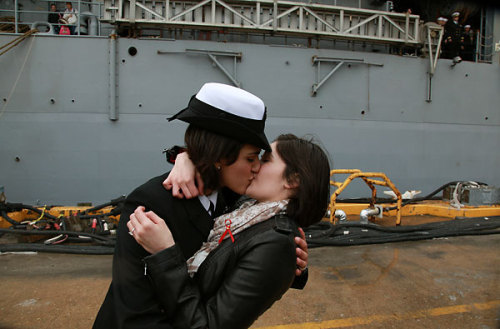 missworded:  yayponies:  It's a time-honored tradition at Navy homecomings – one lucky sailor is chosen to be first off the ship for the long-awaited kiss with a loved one.Today, for the first time, the happily reunited couple was gay. The dock landing ship Oak Hill has been gone for nearly three months, training with military allies in Central America. As the homecoming drew near, the crew and ship's family readiness group sold $1 raffle tickets for the first kiss. Petty Officer 2nd Class Marissa Gaeta bought 50 - which is actually fewer than many people buy, she said, so she was surprised Monday to find out she'd won. Her girlfriend of two years, Petty Officer 3rd Class Citlalic Snell, was waiting when she crossed the brow. They kissed. The crowd cheered. And with that, another vestige of the policy that forced gays to serve in secrecy vanished. By Corinne Reilly The Virginian-Pilot© December 21, 2011   Sniff sniff.  Didn't know this was a thing— very cool.