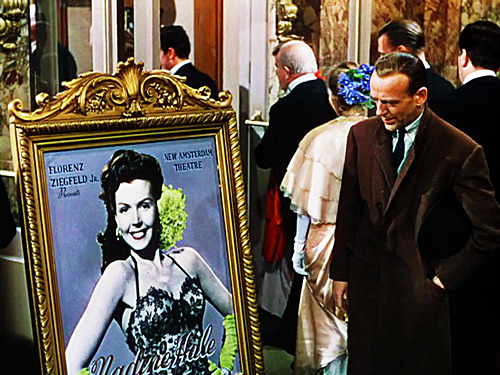 Wearing a dark brown overcoat in Easter Parade (1948).