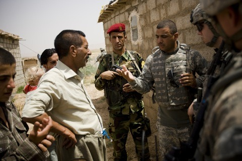 Several thousand Iraqis, including many who helped the United States during the Iraq war, are caught in a grim race between death threats in their own country and the cumbersome process of obtaining a visa. MORE (PHOTO: An interpreter speaks with Kurdish villagers in Al-Hamdaniya district, Iraq. Photo by Warrick Page/Getty Images.)