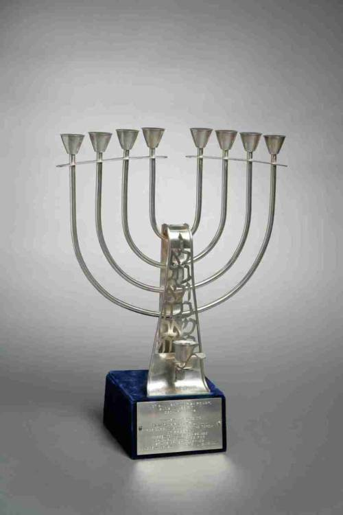 "Happy Hanukkah!  This menorah was given to former President Truman by the Chicago Committee for State of Israel Bonds.  Truman received many honors from numerous Jewish organizations as a result of his decision to recognize the state of Israel in 1948.  The silver plate on the front of this menorah is engraved ""In Warm Tribute to Hon. Harry S. Truman for Carrying Aloft the Torch of Freedom. Presented November 28, 1953, Chicago Committee for State of Israel Bonds."" -from the Truman Library"