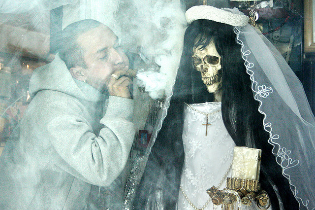 Celebration for the Santa Muerte in Tepito, Mexico City; there are purifying rituals involving the smoking of marijuana, accompanied by mariachi music and mourning hymns.