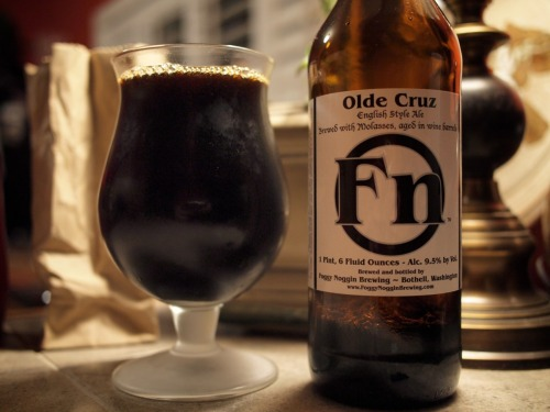 "Foggy Noggin: Olde Cruz the rarest beer in the world?!??! well, probably not, but its pretty rare.. 25 cases only, and probably didn't venture far away from its source in ""lovely"" bothell.  rare or not, beer must be enjoyed—and i wish i had a chance to buy another bottle.  its a english style ""strong"" ale (aka dark) and its pretty f'n delicious.  with all sorts of crazy flavors and really mild carbonation— this beer is really hard not to like.  RIP Cruz, and even tho i never met you, the beer named after you is really really great. Tasting Notes: Dates, Raspberries, Honey, Molasses, Mushrooms, Walking Your Dog in the Pitch Black on a the Winter Solstice"