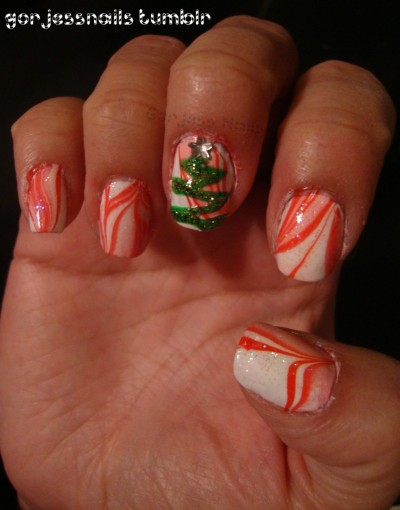 gorjessnails:  Candy cane water marble..  I love how you add extra accents to your water marbles! This is cute!