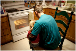 watching the cookies bake with his niece