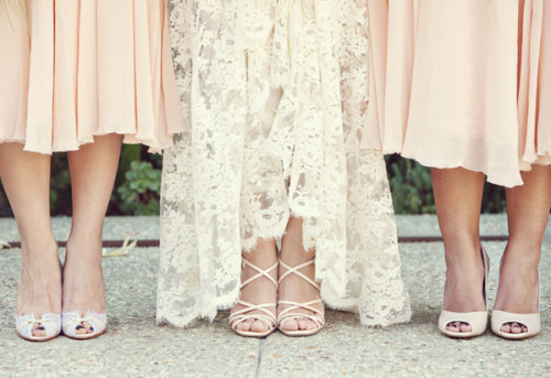 wedding feet, peach bridesmaids and a lace bride