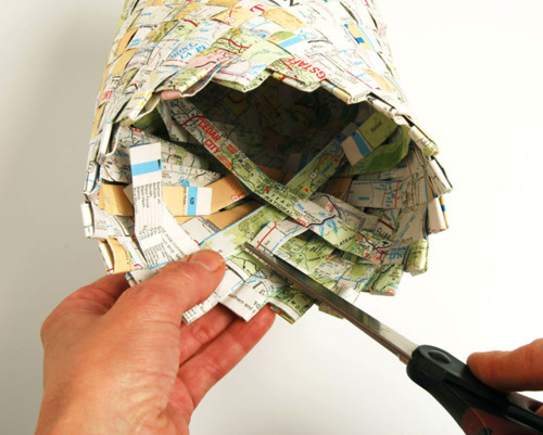 DIY project: Weave outdated maps into baskets.  Strips of newspaper also could be used. For additional photos and a thorough tutorial by Jane Patrick, read Woven Map Basket @Craftzine.com blog. For other map-repurposing ideas, scroll through this series of earlier Unconsumption posts.