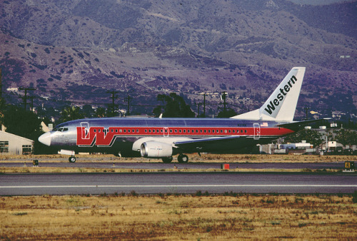 "Western Airlines Boeing 737-347; N3301,June 1985/ CWE by Aero Icarus on Flickr.In the 1980s, Western updated their ""Flying W"" livery with a shadowed W on bare metal. Internally, employees called this scheme ""Bud Light""."