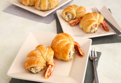 campbellskitchen:  Puff Pastry-Wrapped Jumbo Shrimp 1  package (5.2 ounces) garlic & herb spreadable cheese, softened 1  tablespoon finely chopped fresh parsley 2  slices bacon, cooked and crumbled 18   fresh jumbo shrimp (about 1 pound), peeled with tail left on, deveined and butterflied 1/2  of a 17.3-ounce package Pepperidge Farm® Puff Pastry Sheets (1 sheet), thawed Recipe Steps 1) Heat the oven to 400°F. 2) Stir the cheese, parsley and bacon in a medium bowl.  Spoon about 2 teaspoons cheese mixture down the center of each shrimp.  Fold the sides of the shrimp over the filling. 3) Unfold the pastry sheet on a lightly floured surface.  Cut the pastry sheet crosswise into 18 (1/2-inch wide) strips.  Starting at the top, wind 1 pastry strip around 1 shrimp, slightly overlapping the pastry and ending just before the tail.  Repeat with the remaining pastry strips and shrimp.  Place the pastries onto a baking sheet. 4) Bake for 15 minutes or until the pastries are golden brown.