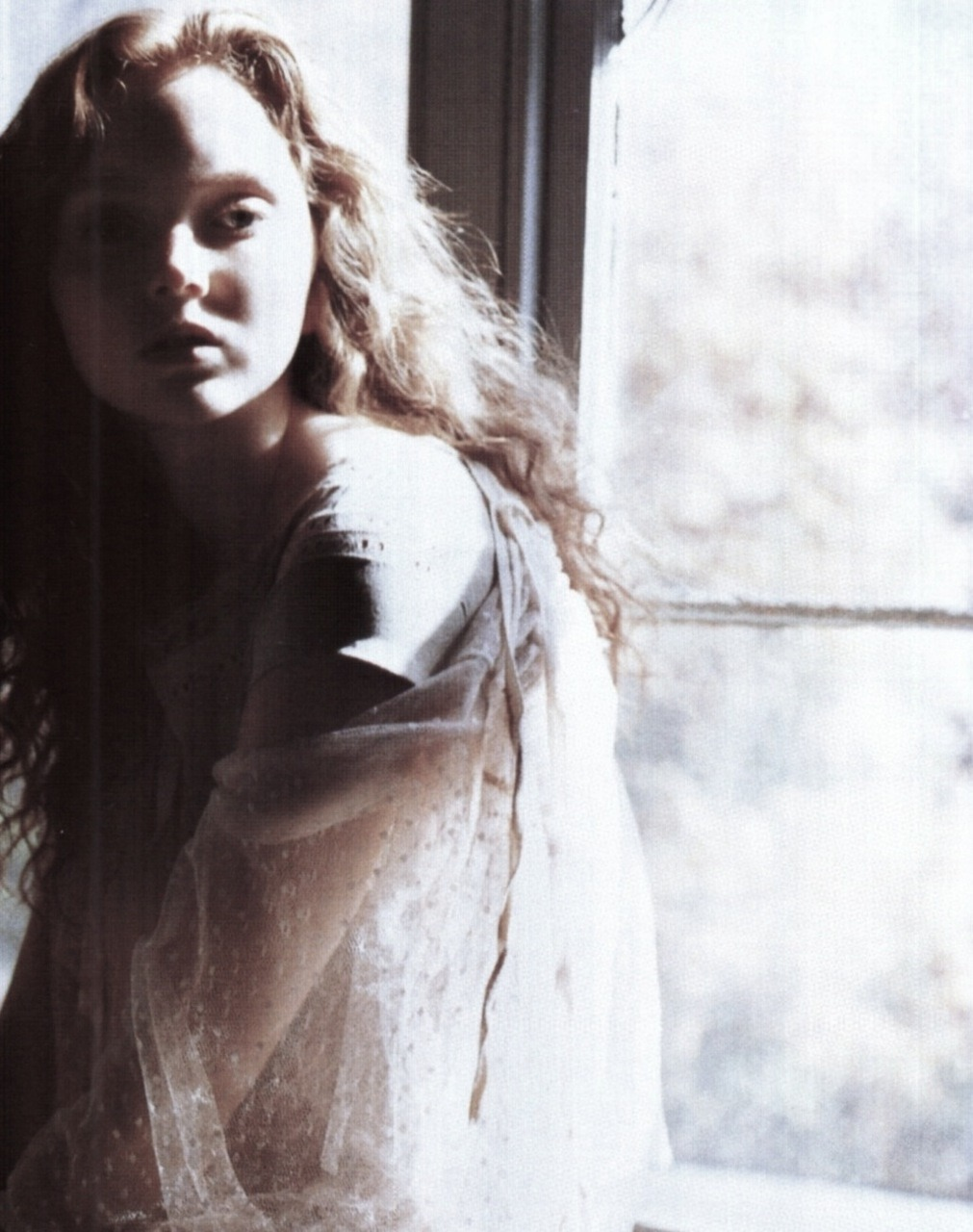 Lily Cole in Dressed in Innocence by Carter Smith for Vogue Nippon March 2006