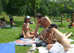 Family Naturism Colony relax while chatting on a nudist camp