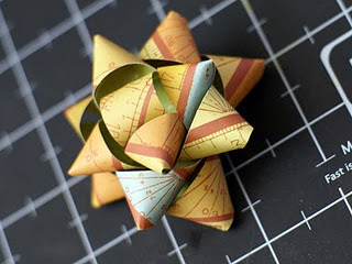 how to make a paper bow.  this would be great to use up those odd sized scraps of wrapping paper
