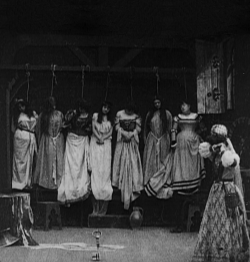 "Bluebeard (1901, dir. Georges Méliès) ""King Bluebeard turned all the keys of the castle over to his wife, saying, 'You may go anywhere in the castle, unlock everything, and look at anything you want to, except for one door, to which this little golden key belongs. If you value your life, you are not allowed to open it!' 'Oh no!' she said, adding that she surely would not open that door. But after the king had been away for a while, she could find no rest for constantly thinking about what there might be in the forbidden chamber. On the morning of the fourth day, she could no longer resist the temptation, and taking the key she secretly crept to the room, stuck the key into the lock, and opened the door."" -Charles Perrault, Bluebeard"