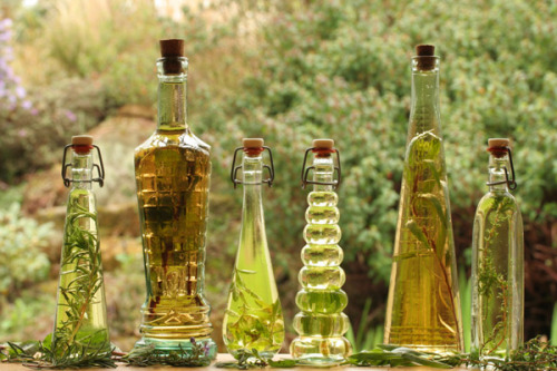 the-vegan-crockpot:  Herbal Culinary Infusions The mere thought of oils, vinegars and salts infused with the essence of savory herbs is enough to make the taste buds swoon. Simple to concoct, these preparations are eminently useful for creating flavorful dressings, marinades, rubs, beverages, vinaigrettes, sauces, and so much more. When packaged into pretty glass bottles or jars with a label, they make a perfect gift that anyone is sure to enjoy.
