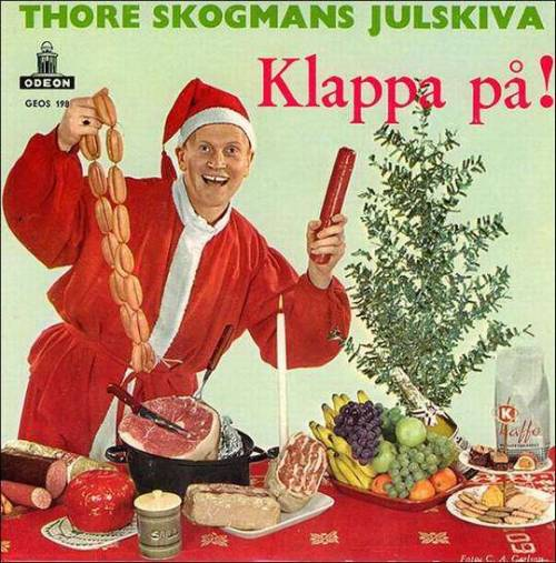 Thore Skogmans Julskiva (and the incredibly awesome cover for his album Klappa på! ) want to make sure you don't forget to include plenty of meat in your holiday celebrations. In fact, this might not just be a friendly reminder. It might be more of a menacing, dead-eyed, sausage wielding threat.  [image via BabsBloggin] It's Santa Day on Geyser of Awesome!