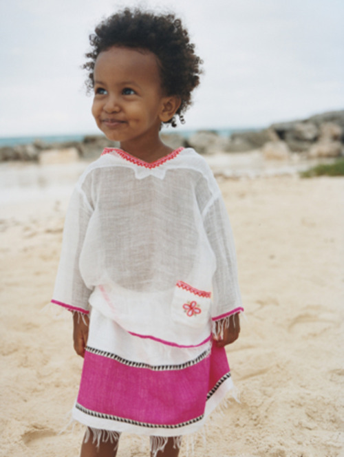 Children of God Little girl with the cutest smile on the beach my-africa-is-beautiful:  From Liya Kebede's clothing line, Lemlem