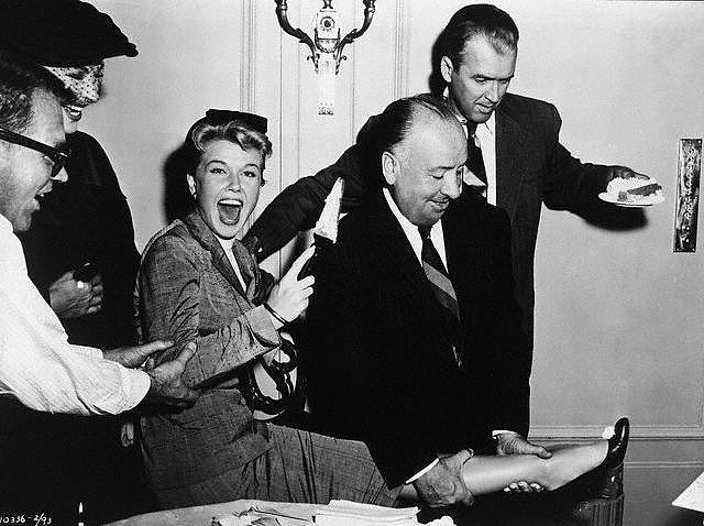 hitchcocksmuse:  Doris Day, Jimmy Stewart, and Director Alfred Hitchcock celebrate Day's birthday with a surprise party on the set of The Man Who Knew Too Much