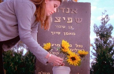 Anouk Spitzer places flowers at her father, Andre Spitzer's grave. Anouk was just two months old when her father, the Israeli fencing coach, was murdered by Palestinian terrorists during the Munich Olympics in 1972.