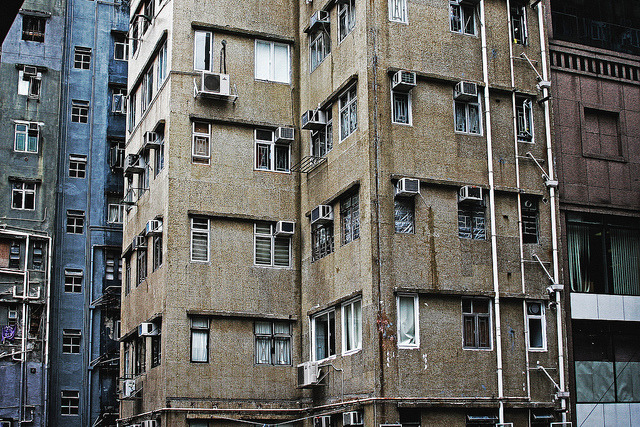 Air conditioning units stick out of Hong Kong apartments by Edwin Budhi on Flickr.