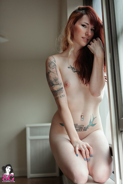 suicidegirls:  Enjoy some quiet time with redheaded bombshell Rogue