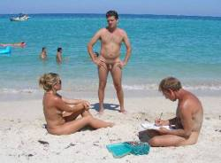 Family Naturism vacationing on the beach while relaxing and sunbathing on the beach with beautiful white sand is a beautiful thing