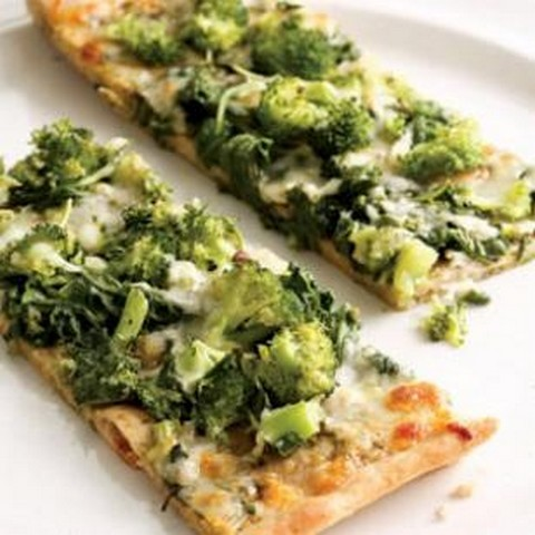 health-heaven:   Green Pizza    1 pound prepared pizza dough, preferably whole-wheat    2 cups chopped broccoli florets    1/4 cup water    5 ounces arugula ,any tough stems removed, chopped (about 6 cups)    Pinch of salt    Freshly ground pepper to taste    1/2 cup prepared pesto    1 cup shredded part-skim mozzarella cheesePosition oven rack in the lowest position; preheat to 450°F. Coat a large baking sheet with cooking spray.Roll out dough on a lightly floured surface to about the size of the baking sheet. Transfer to the baking sheet. Bake until puffed and lightly crisped on the bottom, 8 to 10 minutes.   Meanwhile, cook broccoli and water in a large skillet over medium heat, covered, until the broccoli is crisp-tender, about 3 minutes. Stir in arugula and cook, stirring, until wilted, 1 to 2 minutes more. Season with salt and pepper.    Spread pesto evenly over the crust, top with the broccoli mixture and sprinkle with cheese. Bake until crispy and golden and the cheese is melted, 8 to 10 minutes.NutritionPer serving: 323 calories; 13 g fat ( 4 g sat , 7 g mono ); 19 mg cholesterol; 33 g carbohydrates; 15 g protein; 3 g fiber; 511 mg sodium; 241 mg potassium.Nutrition Bonus: Vitamin C (45% daily value), Calcium (34% dv), Vitamin A (31% dv).Carbohydrate Servings: 2Exchanges: 2 starch, 1 vegetable, 1 medium fat meat, 1 1/2 fat  Might make this this weekend. :-)