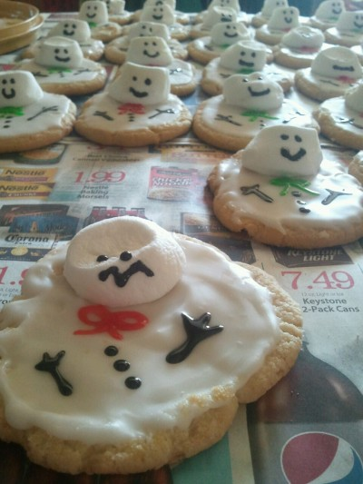 Melted snowman cookies. My mom baked them, frosted them, and individually attached all their smushy marshmallow heads. I'm just helping decorate.  Being home is awesome.