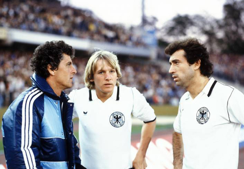 A 20 year old Bernd Schuster listening to Germany's assistant coach Erich Ribbeck (l) and veteran player Bernd Cullmann at the 1980 European championship.  Schuster was voted the Player of the Tournament and secured a move to Barcelona shortly after.