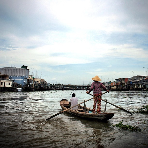A #Viet woman rows the boat on the #Mekong #River, in the #MekongRiver #Delta in the south of #Vietnam. This one was taken earlier this year on my #canon #dslr. #instagram #photo #travel #photography #boat #rowing (Taken with instagram)
