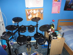 Here is my new Alesis DM 10 Studio kit now in my room. Two drum kits in here now xD I hope to get some videos up in the New Year, I have two songs almost ready to record!