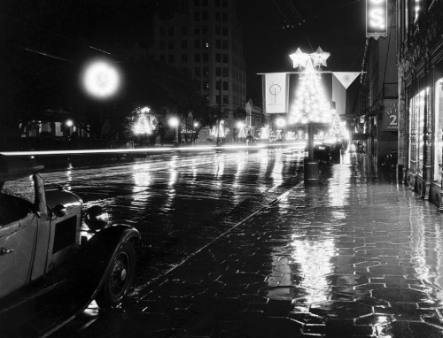 A rain-soaked Hollywood Boulevard, decorated for the holidays as Santa Claus Lane, circa 1930s.