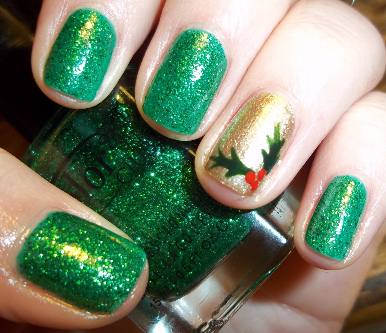Not sure the name of the green glitter. Some no name Color Club polish. The gold is OPI Glitzerland.