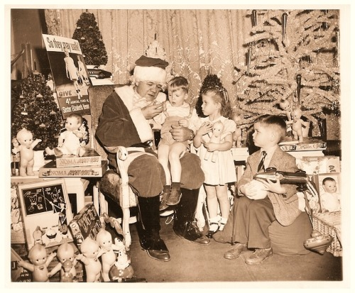 1947 Babe Ruth Plays Santa Claus Babe Ruth plays Santa at the Hotel Astor and presents gifts to fifty polio victim children in New York.