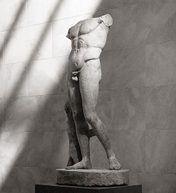 Roman marble statue of the Diadoumenos, copy of a work attributed to Polykleitos, 1st-2nd century CE, 67-1/4 in. (height) Metropolitan Museum of Art