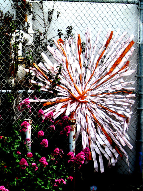 streetartsf:  Ribbon Graffiti Flower. Taken May 2010. 3rd @20th Street in San Francisco, CA.  Looks like Josh and Mimi's Mundane Journey
