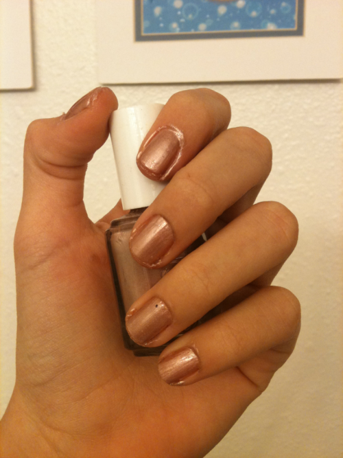 "This is "" Buy me a cameo"" by: Essie       I decided to go for a more neutral color because sometimes all the different colors of Christmas can be overwhelming. I did add a bit of a Christmas touch by applying a glitter top coat which of course doesn't show up on camera.        I would describe this as a rose gold color. I think that it may be more of a spring color but I think that if you're going to do a neutral color for the winter, this is the way to go."