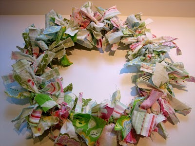 make a wreath from scrap fabric.  this would be cute in a heart design too