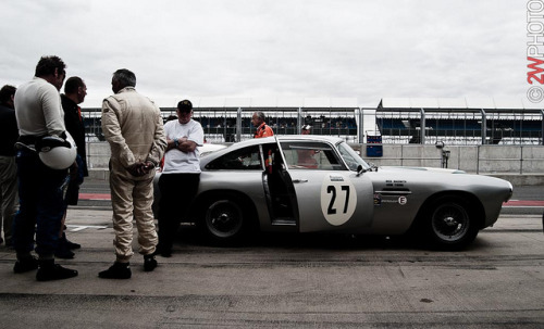Mid-race intermission on Flickr.Via Flickr: The Aston Martin DB4 of Naismith/Young awaiting for the race to be restarted following an incident that red-flagged the race, that driver was taken to hospital for standard medical checkups although okay. Silverstone Classics 23-25 July 2010.