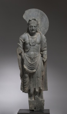 Gandharan sculpture of Bodhisattva from Kushan Period, late 2nd century, gray schist, 52-1/8 in. (height). The Cleveland Museum of Art