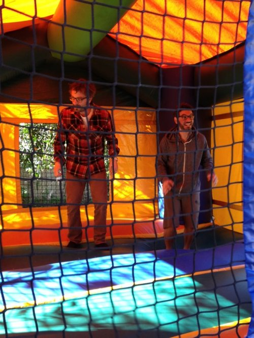 Marc Maron [SF90s] and Al Madrigal [Native] in a bouncy house. [AAAAAAAAAAAAAAAH! THIS IS HAPPENING!]