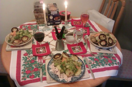 Merry Christmas! Our Christmas lunch! Including cabbage, broccoli, sprouts, new potatoes, roast potatoes, mashed carrots and parsnips, stuffing, Yorkshire puddings and chicken! (Although mother's boyfriend had beef) The one on the left is mine, with a large glass of mulled wine ;) Perfect lunch!