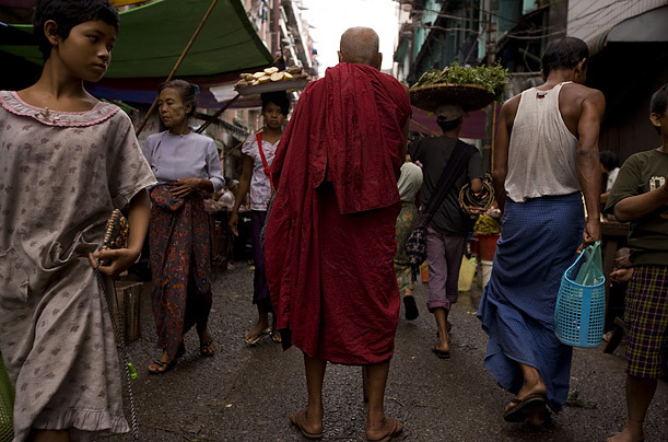 The lives of the Buddhist Burmese are closely intertwined with the lives of the monks, 2007, Burma/Myanmar. [Credit : James Nachtwey] [via]