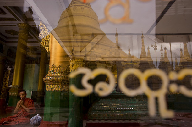 A monk prays at Shwedagon Pagoda, Burma/Myanmar. [Credit : James Nachtwey] [via]