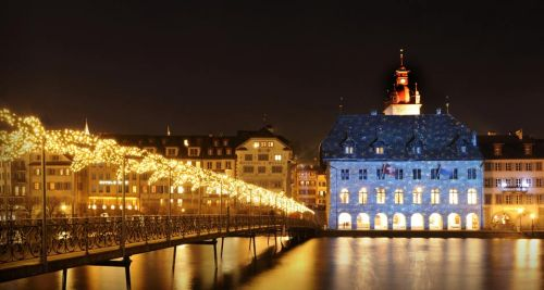 Lucerne Town Hall illuminated with Christmas lights by artist Gerry Hofstetter, Lucerne, Switzerland (© Stefan Huwiler/Photolibrary)