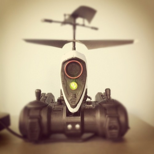 postvideo:  Micro-Drone Journalism? lensblr:  Mini RC helicopter with built in camera: #bestgiftever? (Taken with instagram)  I posted to my own tumblr a few days ago about a Christmas gift I had gotten—an RC copter with camera. After buzzing around the office with it today and yesterday, I'm pretty sure I could actually use this on assignment. The video quality is low, and indoors I crash quite a bit (see below), but I think I might be able to work it into a project.