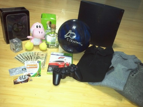 Giorgio Armani Cologne Pink Yoshi (To match with green Yoshi) Bottle of Patron Brunswick C (System) 4.5 Bowling Ball PS3 $450 (Including card) Forza Motorsport 4 A|X clothes.  Pretty awesome presents if you ask me.