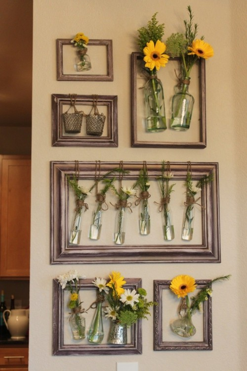 reblog to find later fuckyeahmakingstuff:    Wall Vases, hung via frames   A Cluster of different sized frames with different molding, mix matched is best 1 pint of Martha Stewart's fresh linen white paint 1 pint of another desired color, to go over the white – I used Martha's new metallic line, and I gotta say, was really disappointed at how damn purple it looked. It read brown on the swatch. Sand paper Twine Screws and Mollys A Drill Screw Driver Lots of little vases with a lip, or other small trinkets that will work well hanging from twine. As previously mentioned, you can use old frames of all sizes, or simply go out a buy a bundle of frames that you think look good together. I went to Hobby Lobby on Memorial Day and bought all of these frames on the cheap.  I wasn't concerned with color since I knew I'd be painting them.  I was looking for a molding that I liked, with an adequate amount of space in the middle for something to hang.  I also looked for various small jars, vases and votives to fill the center of the frames.  When I got them home, I sanded the frames to allow the paint to adhere. I then painted 2 coats of the white paint.  I knew I'd be sanding again and didn't want the original finish showing through.  After those dried, I took a dry brush and applied the metallic color.  Now, I was not, and still am not, please about the color this reads.  It was supposed to be brown, not purple. Of all the colors in the world, I hate purple. (Sorry, Kelley…) Anyway, dry brush your top coat on, and don't completely cover the white, let a good amount of it shine through. Once that dries, sand it again until you have the finish you want.  I wanted mine to look super aged, so I really went for it.  Then you want to start hanging them on the wall. First, lay it out on the floor the way you want it so you don't mess it up too bad.  Hang the first frame by drilling holes, pushing in the molly's, and screwing in the screws.  Then hang the frame and make sure it's level.  Measure the distance between that frame and where you want to have your other frame start.  Add that number to the height of the frame and drill your next holes there, and so on and so on. Once the frames are in the right place, remove them one at a time to tie the vases.  Take the twine, and create a pull through loop around the frame.  Wrap the twine around the neck of the vase 5 times, moving the twine in opposite directions around it to secure it well. Tie in a pretty bow. Repeat with the rest of the frames and vases.  And fill them with the seasons freshest flowers!  How's that for a wallflower? (Source.)