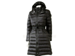 Black quilted puffer coat by Moncler. This Moncler Jackets Women has a   two way centre front zip fastening and two front diagonal  zipped pockets. The   left arm has a compressed stud patch pocket with  the Moncler logo. It has a high   collar with a  detachable elasticated hood with toggles with compressed stud    fastening. Composition : nylon : 100 % Lining : feathers : 100 %  ,Delicate Wash and Gentle Dry Clean.