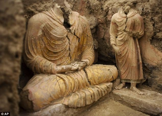 Historic find: Ancient Buddha statues inside a temple in Mes Aynak,  south of Kabul, Afghanistan. Chinese labourers digging a copper mine  made the astonishing discovery A Chinese  company digging an unexploited copper mine in Afghanistan has unearthed  ancient statues of Buddha in a sprawling 2,600-year-old Buddhist  monastery. Archaeologists are rushing to salvage what they can  from a major 7th century B.C. religious site along the famed Silk Road  connecting Asia and the Middle East. The ruins, including the  monastery and domed shrines known as 'stupas,' will likely be largely  destroyed once work at the mine begins. The ruins were  discovered as labourers excavated the site on behalf of the Chinese  government-backed China Metallurgical Group Corp, which wants to develop  the world's second largest copper mine, lying beneath the ruins. Hanging over the situation is the memory of the Buddhas of Bamiyan —  statues towering up to 180 feet high in central Afghanistan that were  dynamited to the ground in 2001 by the country's then-rulers, the  Taliban, who considered them symbols of paganism. No one wants  to be blamed for similarly razing history at Mes Aynak, in the eastern  province of Logar. MCC wanted to start building the mine by the end of  2011 but under an informal understanding with the Kabul government, it  has given archaeologists three years for a salvage excavation. Archaeologists working on the site since May say that won't be enough time for full preservation.